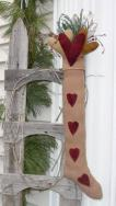 Antique stocking and hearts hanging